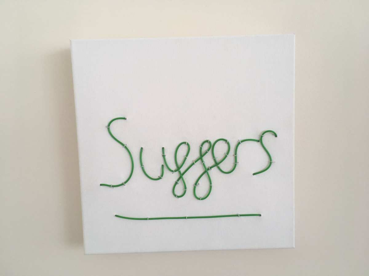 Suffers neon sign on canvas