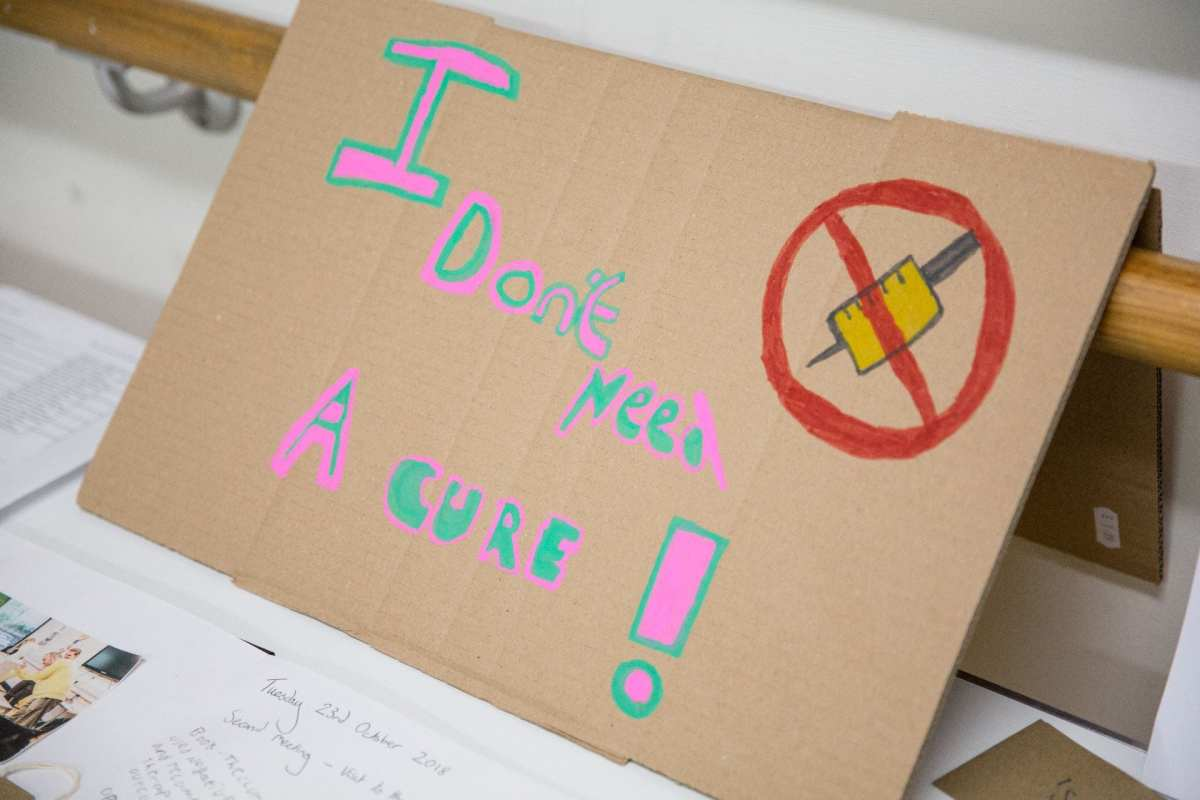 Participants protest sign on display.